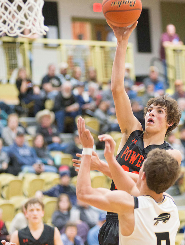 Panther senior Dalton Woodward puts up a shot over a Buffalo defender Saturday night at the East-West Classic in Buffalo. Powell went 0-3 for the tournament, including a 63-53 loss to the Bison.