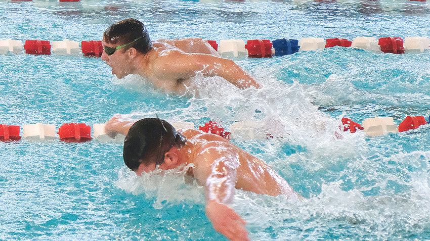 Panther swimmer Richard Spann, top, swims his way to a second place finish in the 100 butterfly at the Riverton Invitational on Saturday. Spann and the rest of the Panther swimming and diving team will take on Riverton in a dual meet in Powell tonight (Tuesday) at 4 p.m.
