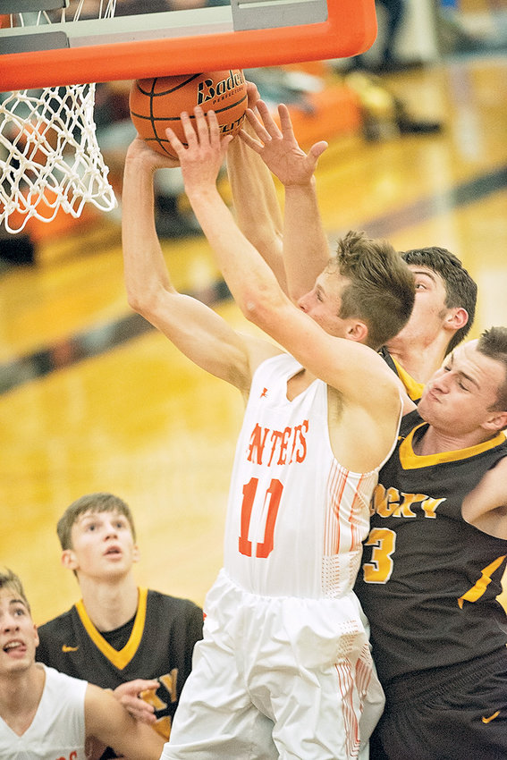 Panther senior Kaelan Groves muscles past Rocky Mountain's Ethan Price for two of his 13 points Friday at Panther Gym. The Panthers came up short against the Grizzlies 65-56.