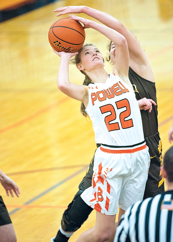 PHS senior Aubrie Stenerson scores two of her game-high 16 points over a Rocky Mountain High School defender Friday at Panther Gym. The Lady Panthers routed the Lady Grizz 42-20 to start 2019 in the win column.