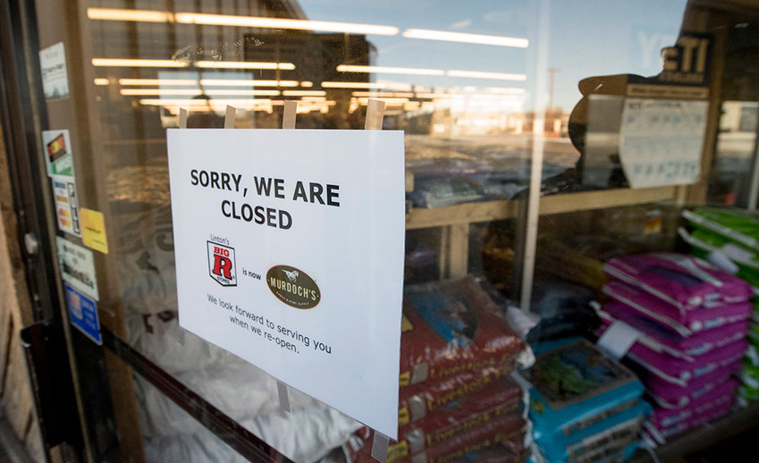 A sign posted on the front door of Linton's Big R on Tuesday announces the store's pending transition to a Murdoch's Ranch & Home Supply.