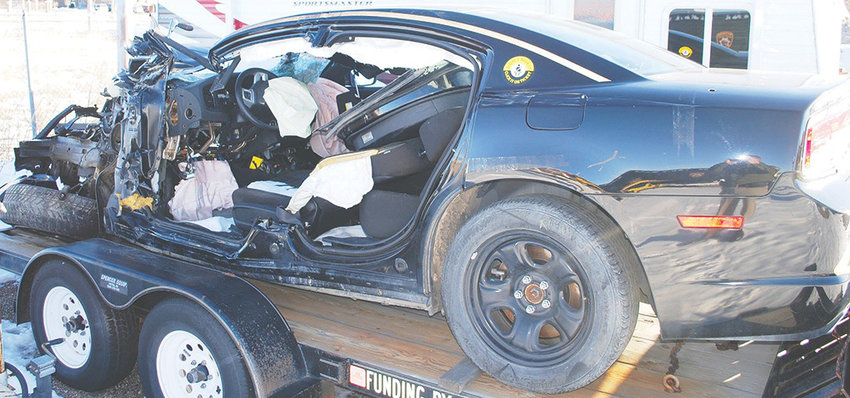 Former Wyoming Highway Patrol Trooper Rodney Miears' patrol car was severely damaged in a 2015 crash in the Wapiti area. Miears has filed a lawsuit in Wyoming's federal court against the company that owned and operated the delivery truck that hit him.