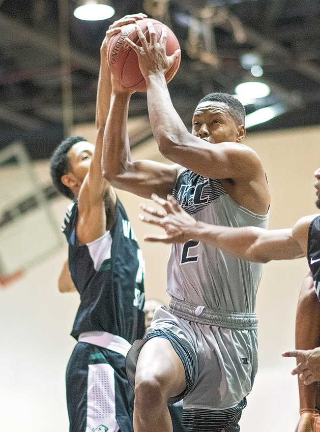 NWC sophomore Reme Torbert battles for a shot against a Williston State defender during a  Saturday game at Cabre Gym. Torbert posted a triple-double in the Trappers' 94-93 OT victory, preventing a season series sweep by the Tetons.