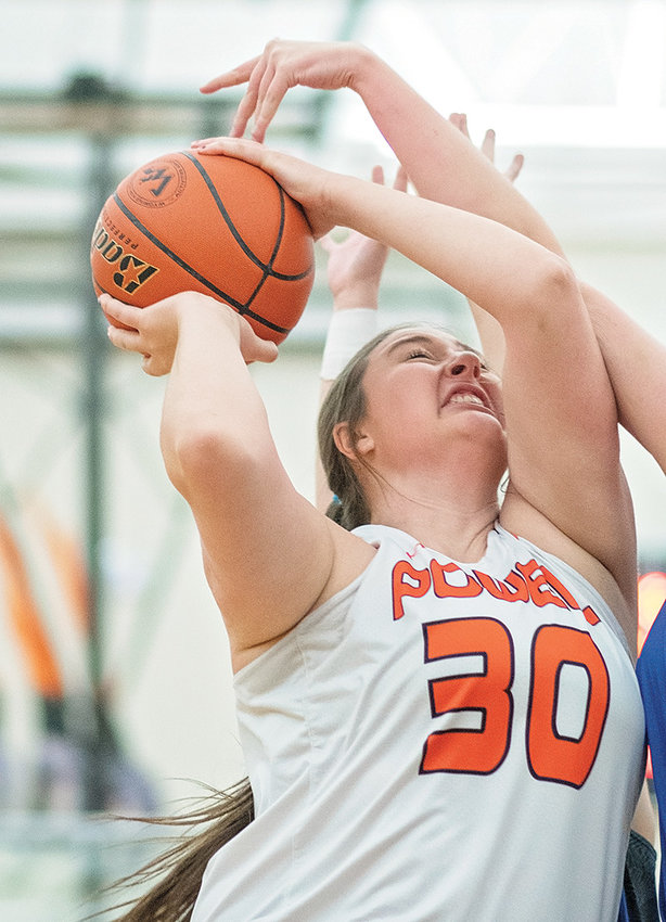Lady Panther Rachel Bonander scores two of her seven points Friday against Lovell at Panther Gym. Powell's stingy defense held the Lady Bulldogs in check for most of the game, coming away with a 33-19 win.