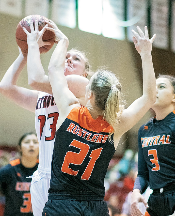 Lady Trapper Berkley Larsen battles for a shot against Central Wyoming's Rylee Burmester last week at Cabre Gym. Northwest made it close before losing 74-69.