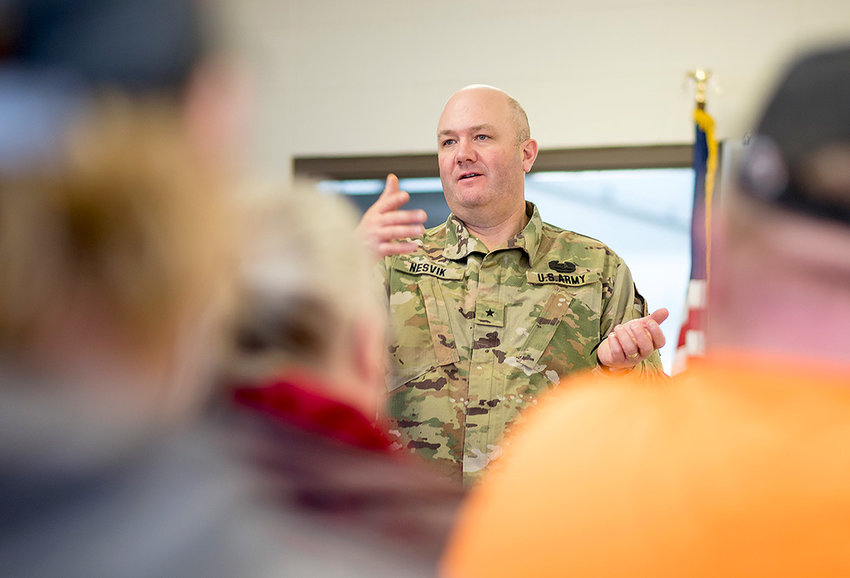 Wyoming Army National Guard Brig. Gen. Brian Nesvik talks to employers at the armory in Worland on Friday in an effort to help ease the upcoming deployment of 350 troops from Wyoming.