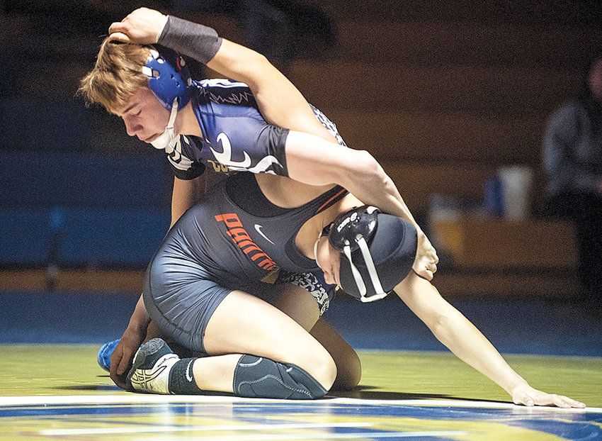 PHS sophomore Emma Karhu begins to break away from Cody's Matthew Stroble in the 113-pound weight class Tuesday evening in Cody. Karhu went on to win the match by pin in the final seconds, bringing the final score to 65-16.