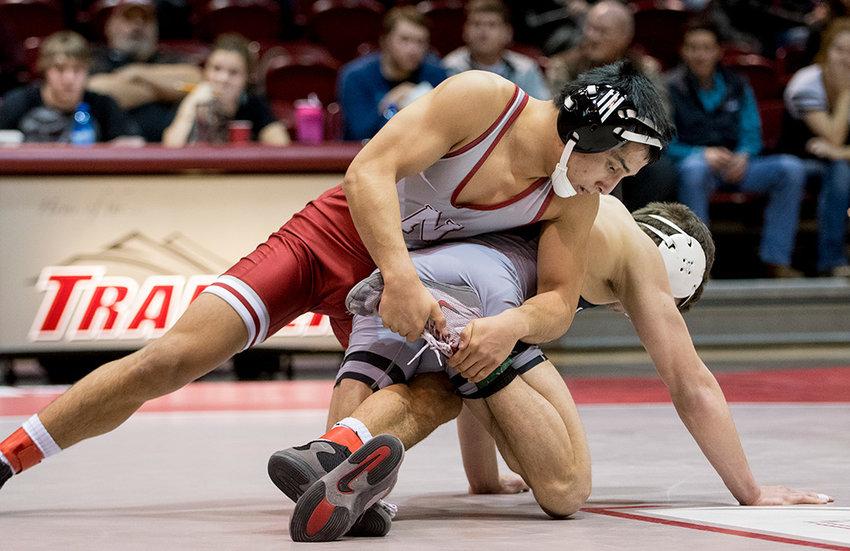 Northwest's Bobur Berdiyarov, 133-pound freshman, works his way to a 5-2 victory over Western Wyoming Community College's Joey Revelli.