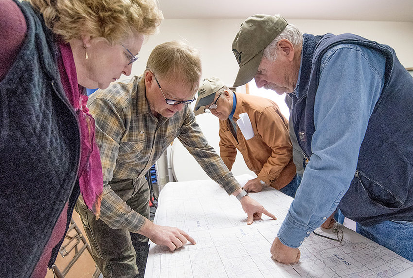 Bret Reed, a professional engineer with Engineering Associates in Powell, helps property owners make sense of maps of the Heart Mountain Irrigation District at a Tuesday meeting. The district hopes to enlarge its adjudicated coverage area by nearly 3,400 acres.