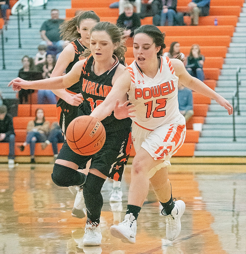 Lady Panther Karlie McKenzie (right) battles Worland's Tymberlynn Crippen for control of the ball Tuesday night at Panther Gym. Powell came up just short in its comeback bid against the Warriors, losing 40-36.