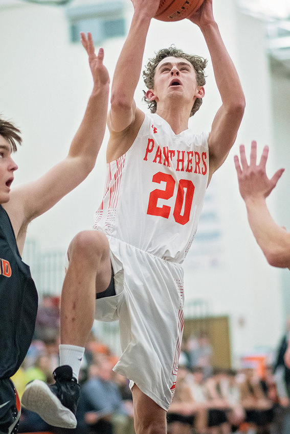 Powell's Jesse Brown goes airborne for a shot against Worland on Tuesday night at Panther Gym. The Panthers won the rubber match against the Warriors 50-35.