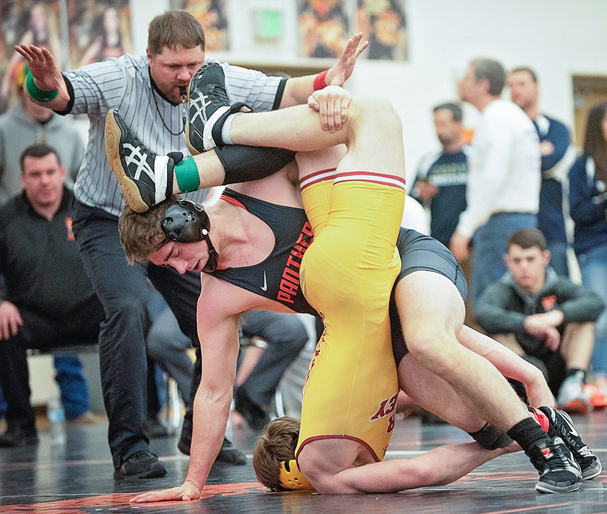 Panther senior Cameron Schmidt pile drives Star Valley opponent Friday evening at Panther Gym during the 3A West Regional tournament. Schmidt won by decision and went on to take fourth in his weight bracket.