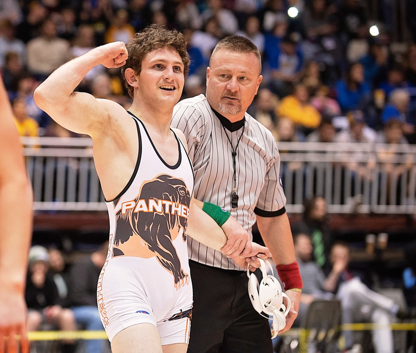 Powell High School senior Reese Karst celebrates after winning his third state title at the Class 3A State Wrestling Championships in Casper on Saturday.