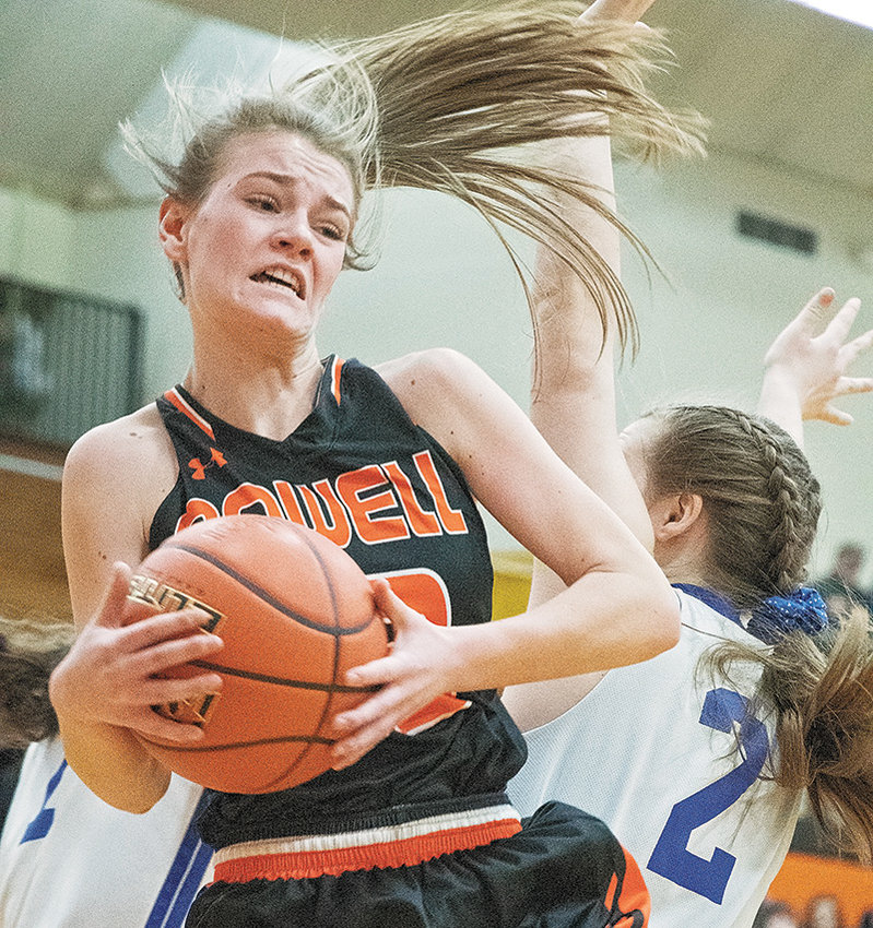 Lady Panther Aubrie Stenerson pulls down a rebound over Lyman's Brice Hansen in the opening game of the 3A West Regional Tournament in Worland. Powell lost Thursday's game, but went on to win the next three to finish third.