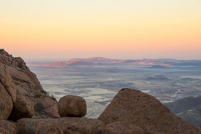 The sun rises on Brandberg Mountain, overlooking the Namib Desert in Namibia. National Geographic adventure writer Mark Jenkins will present 'A Journey into the Ancient Namib Desert: Rock Paintings, a Vanished People and Water Scarcity' on Tuesday at Northwest College.