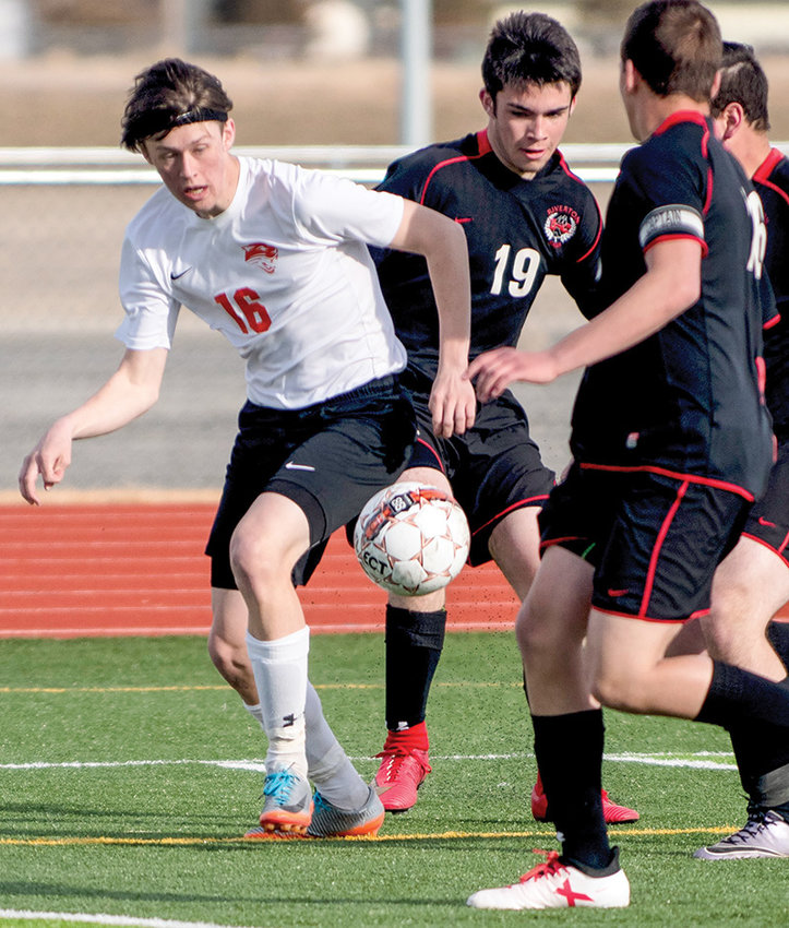 Panther soccer player Sam Bauer works the ball away from a trio of Riverton defenders during a game last season. Bauer and his teammates will open the 2019 season on Saturday in Buffalo, if the weather cooperates.