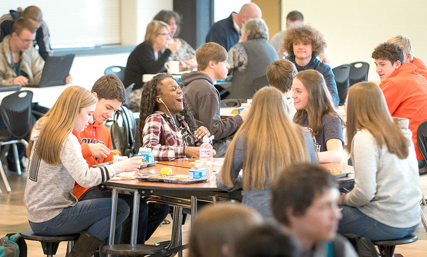 Kalaiah Stenlund (center) laughs with friends during a recent lunch at Powell High School. Seated on the left are Ethan Bartholomew and Kabrie Cannon, with Jayden Asher pictured at right. Enrollment at PHS continues to climb, with another increase expected next year.