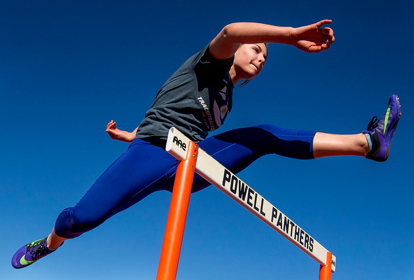 Lady Panther Caitlyn Miner clears a hurdle during practice Tuesday afternoon at Panther Stadium. The PHS track and field team opens the 2019 season on Saturday at the Cody Invitational.