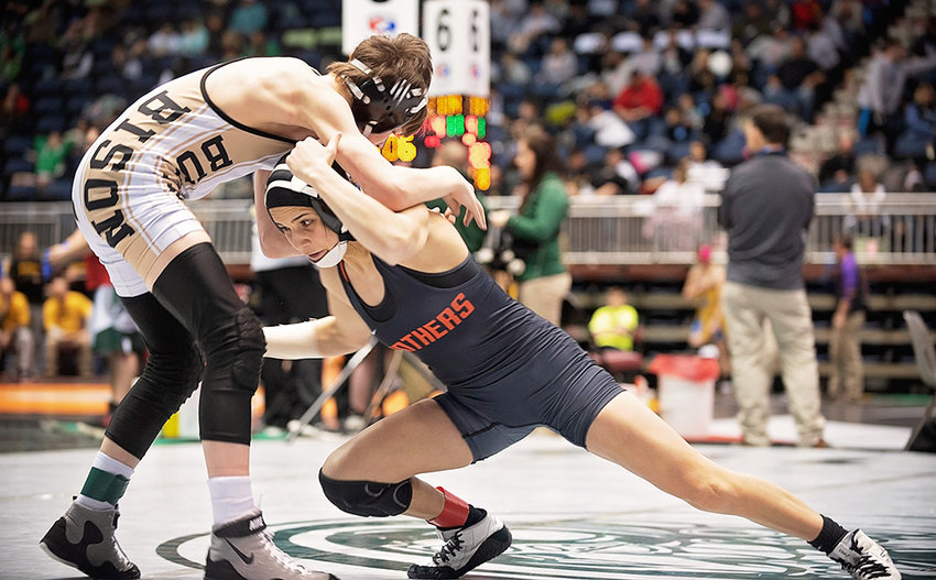 PHS wrestler Emma Karhu, right, shoots in on Buffalo's Mason Myers during the 3A State Wrestling Championships last month in Casper. Karhu finished third over the weekend at the USMC Girls Folkstyle Nationals in Oklahoma City, earning All-American honors.