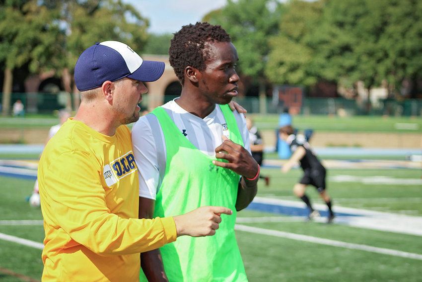 New NWC men's soccer coach Ben McArthur, left, works with a player during a Buena Vista University soccer practice last season. McArthur brings almost a decade of college coaching experience to the Trappers, including five seasons as head coach at BVU.