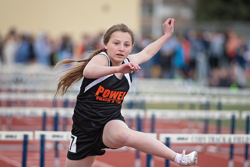 Powell Middle School athlete Aramonie Brinkerhoff competes in the 100 meter hurdles Monday at the April Fool's Double Duals in Cody, finishing eighth. It was the first meet of the season for the middle school track and field teams.