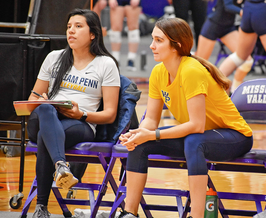 Valerie Rivera, left, works the sidelines for the William Penn University volleyball team, along with fellow graduate assistant Lauren Eldridge. Rivera was hired Monday as Northwest College's interim volleyball coach for the 2019 season.