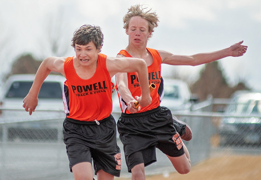 PMS eighth grader Dillon Melton takes the baton from teammate Jack Beaudry during the 4x100 relay on Saturday at the Powell Roundtable Invitational at Panther Stadium. The team of Melton, Beaudry, Sean Kennedy and Terry Durham finished fourth in the event.