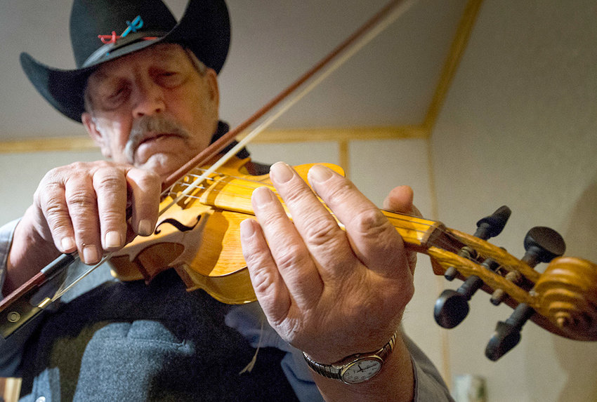 Leonard Torczon plays a fiddle handcrafted by Ed Thull of Clark in 1952. It was the first time in decades that the fiddle had been played.