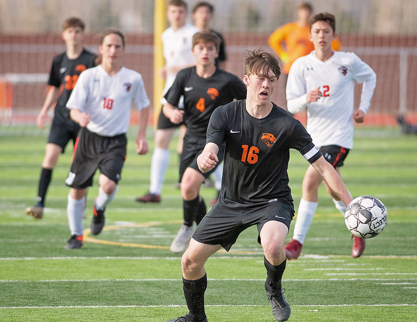 PHS forward Sam Bauer chases down a loose ball during Monday's contest against 3A West rival Riverton at Panther Stadium. The Panthers controlled the pace for most of the game, holding on for a 2-1 win.