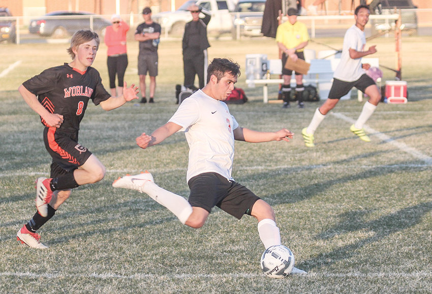PHS forward Ernie Acevedo races up the pitch with the ball Thursday during a game at Worland. The Warriors shut out the Panthers 3-0 to remain undefeated on the season.