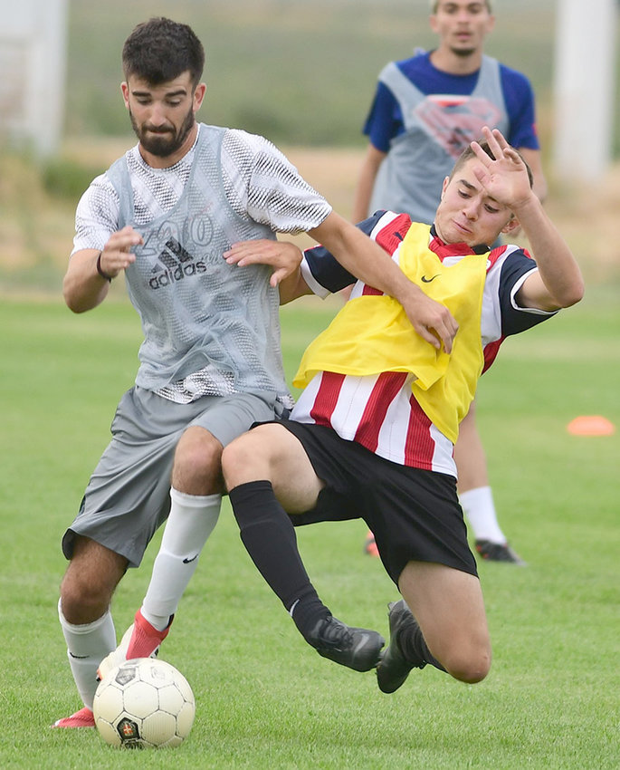 Former NWC soccer player Edgar Meza (right) battles teammate Kyle Lamb for the ball during a practice prior to the 2018 season. After two seasons as a Trapper, Meza will continue his playing career next year at Dakota Wesleyan University in South Dakota.