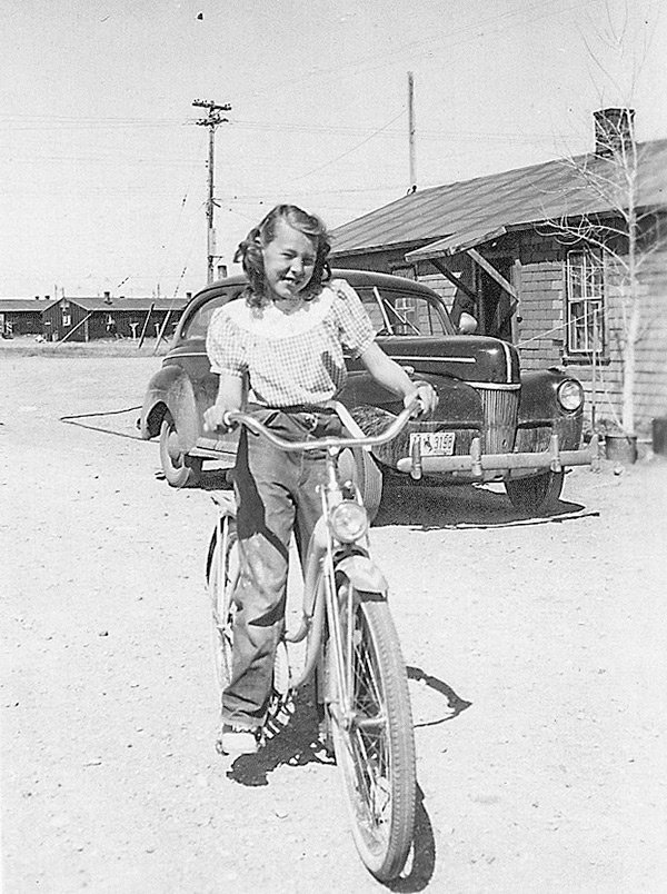 Columnist Pat (Reher) Stuart is pictured outside her family's barrack at the site of the former Heart Mountain Relocation Center.
