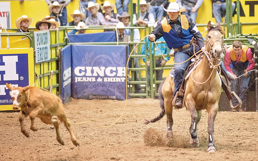 Montana State's Bryce Bott competes in the first round of tie down roping at the 2019 CNFR Monday morning at the Casper Events Center. Bott, a graduate of Powell High School, was in sixth place after the first round of competition.