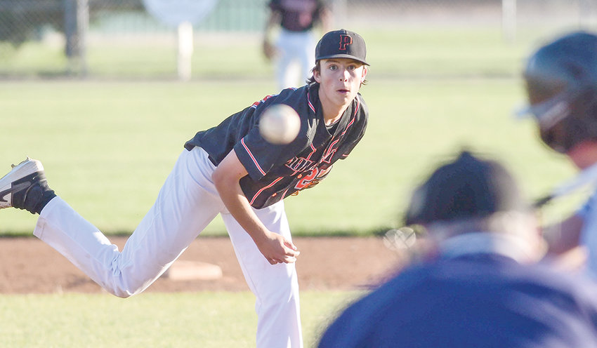 Powell relief pitcher Landon Sessions fires a pitch toward the plate Wednesday against the 406 Flyers.