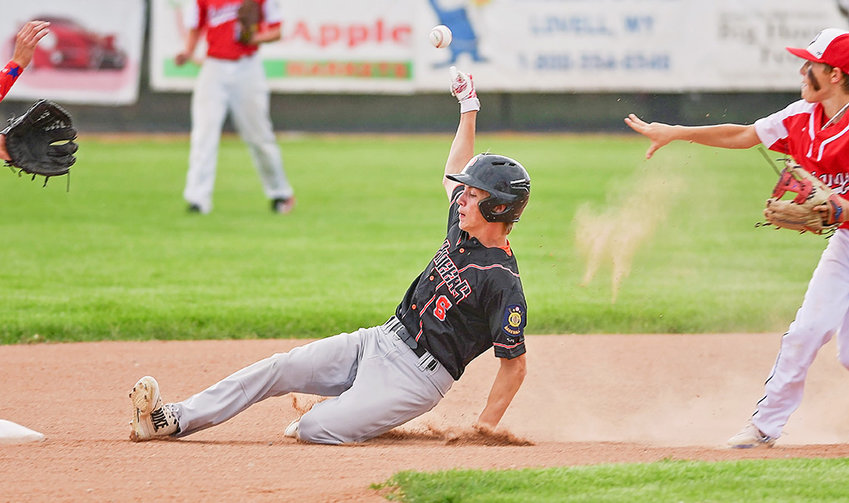 Powell baserunner Kobe Ostermiller slides safely into second base ahead of the throw Tuesday during a game against Lovell in Cowley. The Pioneers swept the doubleheader against the Mustangs.