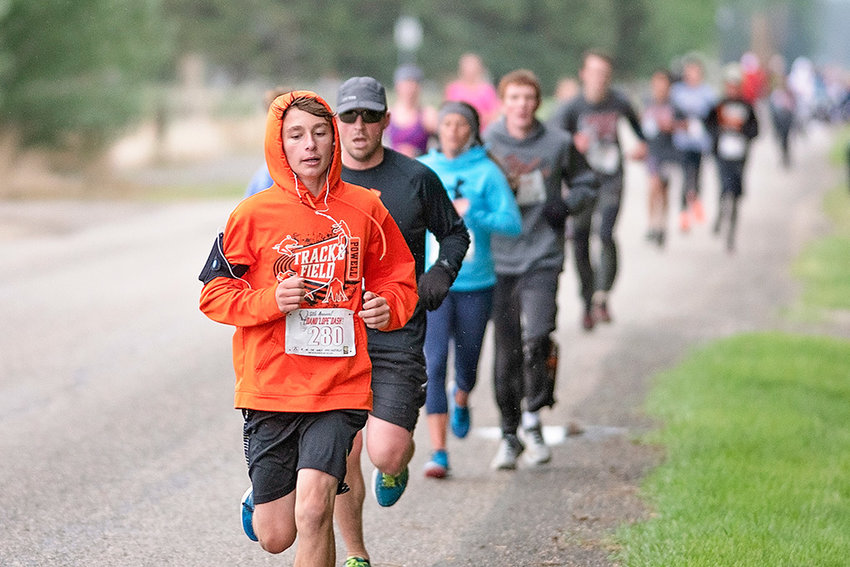 Marshall Lewis (bib no. 280) and Chanler Buck pace the pack Saturday during the eighth annual Dano'lope' Dash. Lewis placed second in the 10K, 11-19 age division.