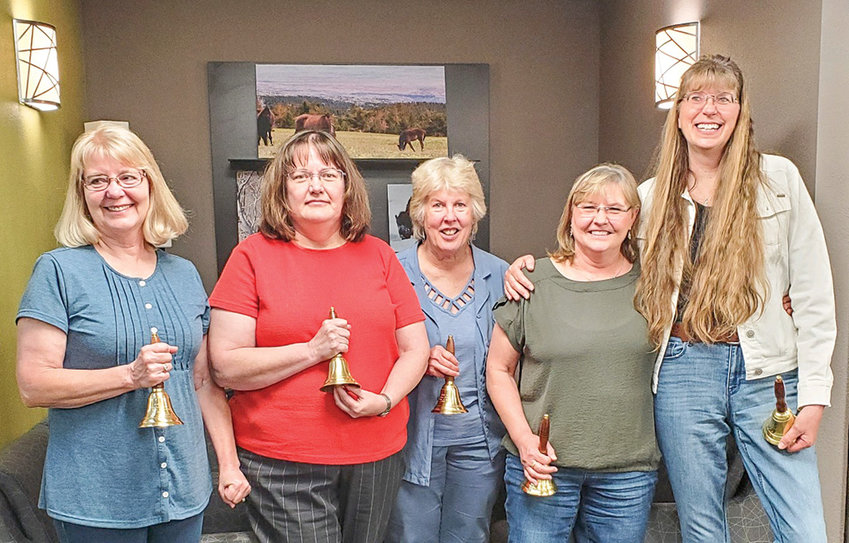 From left, retiring Powell school employees Jocelyn Frame, Gloria Randall, Laurie Smith, Deb Eckhardt and Laurie Zwemer pose for a photograph at a school board meeting last month. The board and school administrators presented the retirees with bells and thanked them for their many years of service.