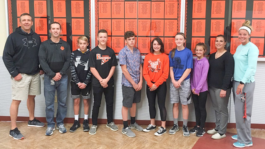 Powell Middle School's 'Top Cub' performers are (from left), sixth-grader Evan Whitlock, seventh-grader Jhett Schwahn, eighth-grader Ryan Cordes, eighth-grader Kami Jensen, seventh-grader Waycee Harvey and flanked by sixth-grader Alexa Richardson. They're flanked by (from left) PE teacher Crosby Tajan, principal Kyle Rohrer, PE/health teacher Jaci Hitz and PE teacher Chelsea Buher.