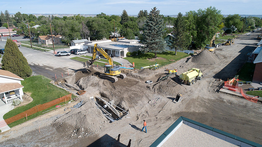 Crews work on the intersection of Absaroka and Third streets Thursday morning. In addition to widening the thoroughfare from Seventh to Third streets, the city is replacing water and storm sewer pipes down much of Absaroka.