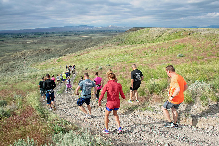 Runners begin the trek downhill from the start line at the top of the Polecat Bench for Saturday's Rec De Plaza Run. Thirty-eight participants competed in the event, the first featuring the revamped course.