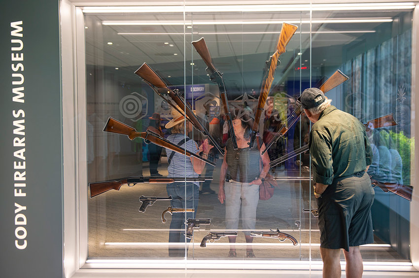 Visitors check out a display near the entrance of the newly renovated Cody Firearms Museum during Saturday's grand opening at the Buffalo Bill Center of the West.