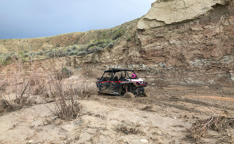 A family of four from Florida got this rented ATV stuck in the mud while riding in the McCullough Peaks area on Monday. The family was assisted by Park County Search and Rescue members.