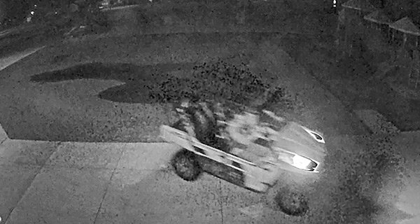 This screencapture from surveillance camera footage shows an ATV driving around Parkside Elementary School early Tuesday morning. The off-road trip reportedly caused damage to lawns at multiple locations.