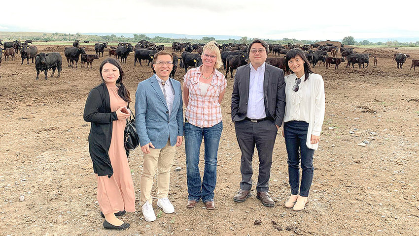 Chester Chu, director of Wyoming's Taiwan trade office (second from left) poses for a photo at Murraymere Farms south of Powell, flanked by Val Murray (center). Chu was in the area to promote opportunities for local businesses to sell their products in Taiwan.