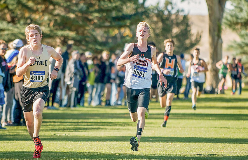 Former Powell High School distance runner Jayden Yates (right) sprints down the home stretch against a Buffalo runner at the Powell Invitational last year. Yates has signed a letter of intent to run cross country for Central Wyoming College next season.