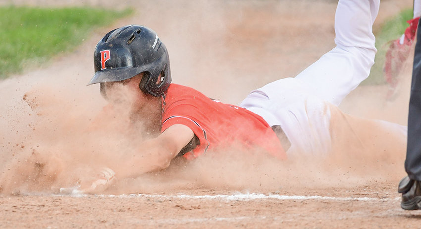 Pioneer baserunner Kobe Ostermiller slides safely into home during a Tuesday doubleheader against Lovell at Ed Lynn Memorial Field. The Pioneers won the first game 8-6, but dropped the second 17-4 to end the regular season.