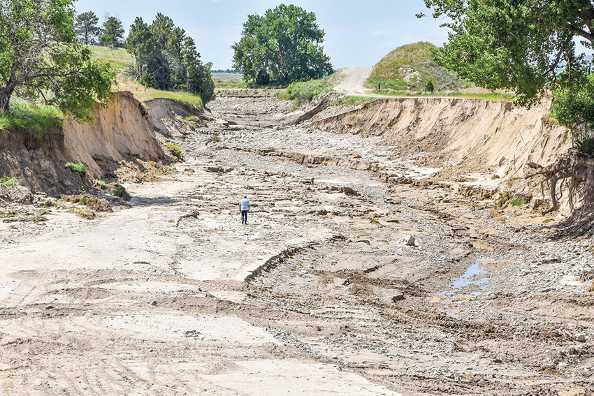 A tunnel collapse and subsequent canal breach last week has left more than 100,000 acres of farmland without water in southeast Wyoming and western Nebraska. Gov. Mark Gordon declared an emergency on Monday after visiting the scene on Friday. 'Find the man in the middle for some perspective on the size of this breach,' Gordon wrote in a Facebook post.