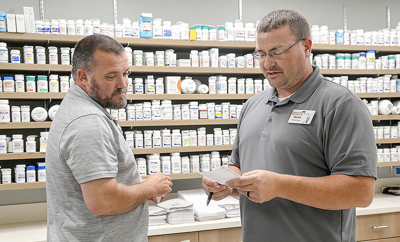 Pharmacists Jason Bishoff and Travis Graham help prepare Powell Valley Healthcare's new retail pharmacy for its opening, which could be as soon as next week. It's among multiple projects aimed at improving the facility.