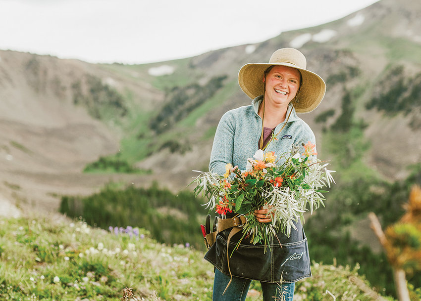 Melissa Urick creates a wildflower bouquet in the mountains earlier this summer. In addition to growing dozens of flower varieties (pictured at left) at Passiflora Farm, Urick is a florist for events and weddings.