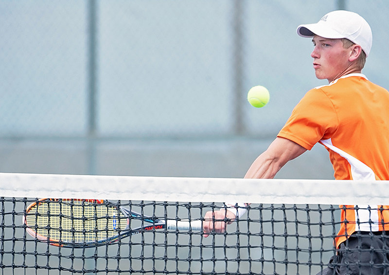 PHS No. 1 doubles player Aidan Jacobsen returns a shot against Rock Springs during a match earlier this month. The Panther and Lady Panther tennis teams traveled to Gillette on Friday, returning home with wins over Thunder Basin and Campbell County.
